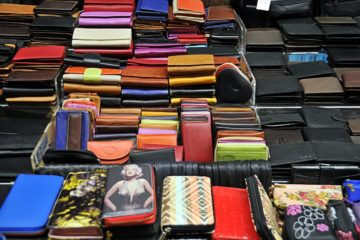 different colored wallets and purses