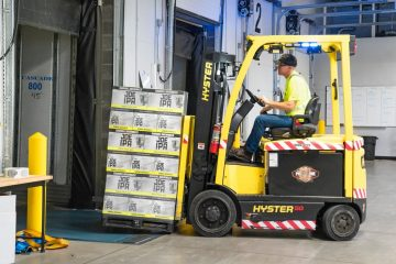 operating forklift in warehouse